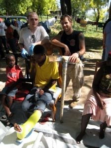 Team Rubicon's Clay Hunt building crutches for victims of the January 2010 earthquake in Haiti.