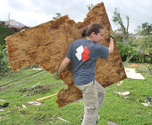 Nicole Green clearing debris after a tornado ripped through the Joplin, Mississippi area.