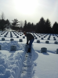 Bob Roberts, Kristie's father, shovels a path to his daughter's headstone.